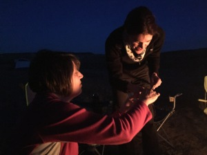 "Aileen, the ""field mom,"" showing Becca how to make her first s'more."